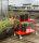 Farbiger Wagen mit 2 Böden, 2 Ebenen, 900 x 440 mm, 250 kg Tragfähigkeit, Rot, mit Bremsen