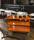 Farbiger Wagen mit 3 Böden, 3 Ebenen, 900 x 440 mm, 250 kg Tragfähigkeit, Orange , ohne Bremsen